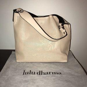 Lulu Dharma CLARA laser cut shoulder bag